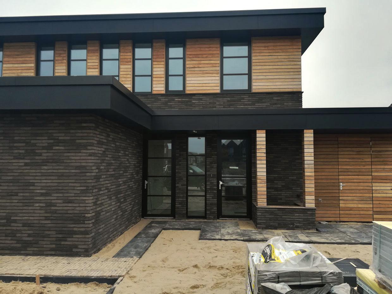 Studio voor Bouwkunst - Frank Lloyd Wright geïnspireerde kubuswoning in natuurlijke materialen steen en hout - Noordereiland, Arnhem